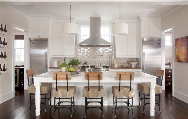 symmetrical-kitchen-in-beautiful-room-with-silver-icebox-and-white-table-and-brown-chair-with-wastafel-and-cool-painting-615x391