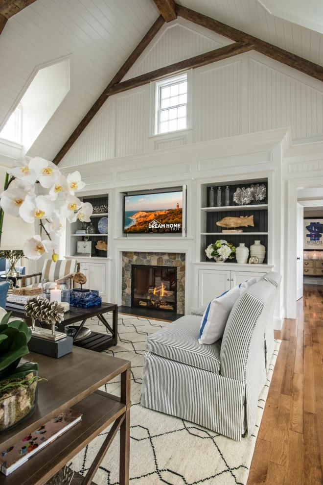 dh2015_great-room_built-in-bookcases-stone-fireplace_v.jpg.rend.hgtvcom.1280.1920