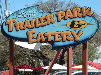 "The cornerstone in the South Austin Trailer Park Eatery is the legendary taco truck, Torchy's. They feature over 14 types of tacos. The Trailer Park itself has a handful of food truck options (Torchy's, Man Eat Dog, Holy Cacao) and much welcome shade trees, fans, picnic tables and lawn chairs. (Be forewarned - the parking is limited, and First St is heavily trafficked.) ""Best Road Trip Ever!"" http://itunes.apple.com/us/app/best-road-trip-ever!/id374940747?mt=8"